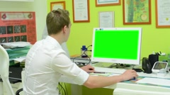 Man works on computer - green screen - surgery (office) Stock Footage
