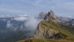 Time lapse clouds seceda geissler mountain summit wide pan 11550 Stock Footage