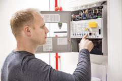 Technician checks fire panel in data center Kuvituskuvat