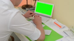 Man works on computer - green screen - office Stock Footage