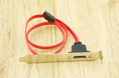 red cable of serial ata for harddisk sata - stock photo
