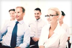 Businessmen and businesswomen on conference Stock Photos
