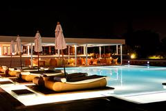 Swimming pool and bar in night illumination at the luxury hotel, crete island Stock Photos