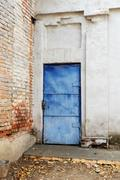 Blue vintage mediterranean door in obsolete wall and a lot of copyspace Stock Photos