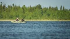 Poljarnie zori, russia - circa jun 2014: fishermen go fishing in a rubber inf Stock Footage