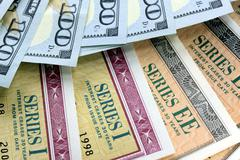 United States Savings Bonds with American Currency Stock Photos