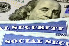 Social security card and US currency one hundred dollar bill Stock Photos