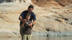 father and son fishing - stock footage