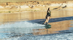 Woman wakeboarding Stock Footage
