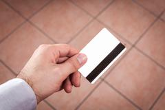 hand holding up a credit card - stock photo
