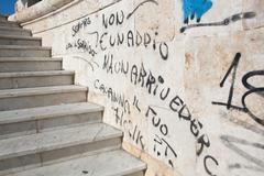 "curios graffiti in cagliari ""there's not a farewell, but goodbye"" - stock photo"