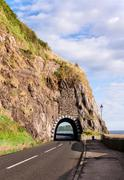Coast road with tunnel, northern ireland Stock Photos