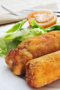 spanish flamenquines, breaded pork loin rolled with serrano ham, typical of a - stock photo