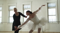 Instructor working with a ballerina Stock Footage