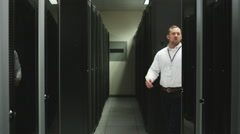 Man giving a tour of a server room Stock Footage