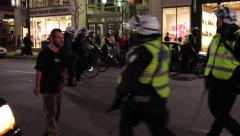 Riot officers pushing arrogant man multiple times during mass gathering Stock Footage