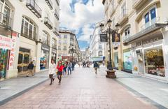 people walking in a commercial street in zaragoza , spain - stock photo