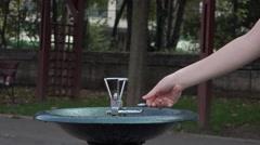 ULTRA HD 4K Woman hand press tap drinking fresh water public park hot summer day Stock Footage