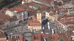ULTRA HD 4K Aerial view Sfatului Square Brasov old town sunny day iconic build Stock Footage