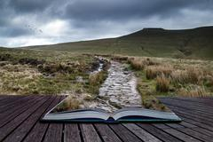 Beautiful landscape of brecon beacons national park with moody sky conceptual Stock Photos