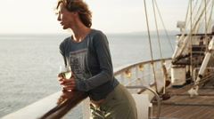Woman on a yacht having a glass of wine Stock Footage