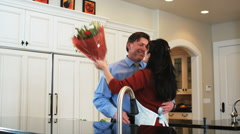 Man coming home from work with flowers for his wife Stock Footage
