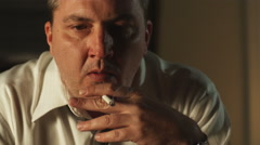 Man smoking a cigarette while coughing Stock Footage