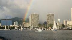 Rainbow, ala wai yacht harbor, sailboat race, waikiki, honolulu, hawaii Stock Footage