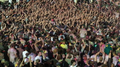 Crowd of people waving their arms in the air Stock Footage