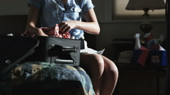 Hotel maid stealing money out of a suitcase Stock Footage