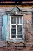 Obsolete wooden window in traditional tribal Russian style in Astrakhan Stock Photos