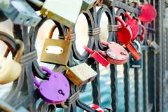 Wedding locks on bridge fence in Astrakhan, Russia Stock Photos