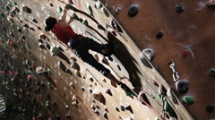 woman on an indoor climbing wall - stock footage