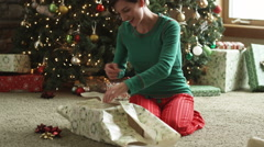 Two girls tackling their mother on Christmas morning Stock Footage