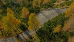 AERIAL: Biker driving over the mountain pass in autumn - stock footage