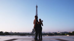Couple asking a man to take their photo in front of the Eiffel tower Stock Footage