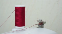 Winding Up a Sewing Bobbin With Thread - stock footage