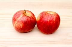 apples on wooden background - stock photo
