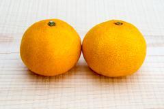 oranges on wooden base - stock photo