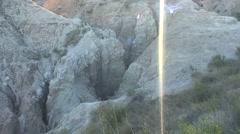Badlands Badlands National Park Summer Sun Flare Backlighting Tilt Up - stock footage