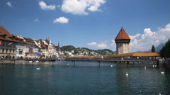 European cityscape of a river, a bridge and buildings Stock Footage
