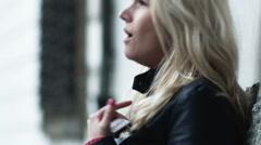 Woman smoking a cigarette and coughing Stock Footage