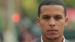 Young African American black Latino man in city serious face portrait - stock footage