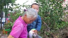 Shenzhen village, grandma with grandson Stock Footage