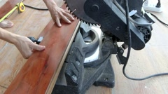 Young carpenter using a circular saw to cut wood pieces Stock Footage