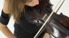 Amazing girl playing the violin melody - stock footage