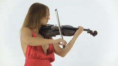 Talented girl in a long dress emotionally plays the violin - stock footage