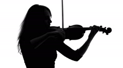 Silhouette of a girl playing the violin Stock Footage