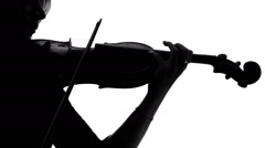 Close up of silhouette of violinist playing on her a musical instrument Stock Footage