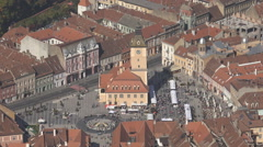 Aerial view Sfatului Square Brasov old town sunny day iconic building tourism Stock Footage